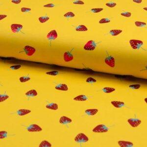 Tela de punto amarilla con fresas