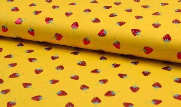Tela de punto amarillo con fresas