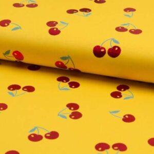 Tela punto amarilla con cerezas